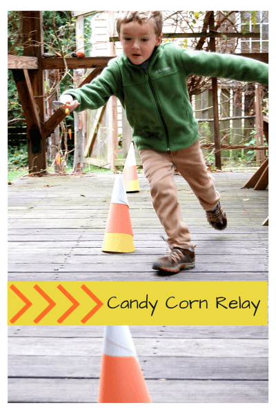 Child playing halloween activities for kids candy corn relay