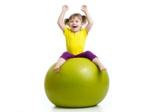 The Inspired Treehouse - These fun physical activities for kids require only two simple things - a therapy ball and some space to play!