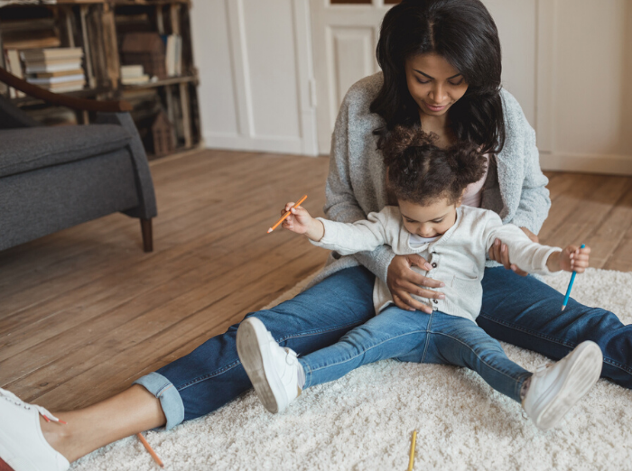 mom and child playing on floor