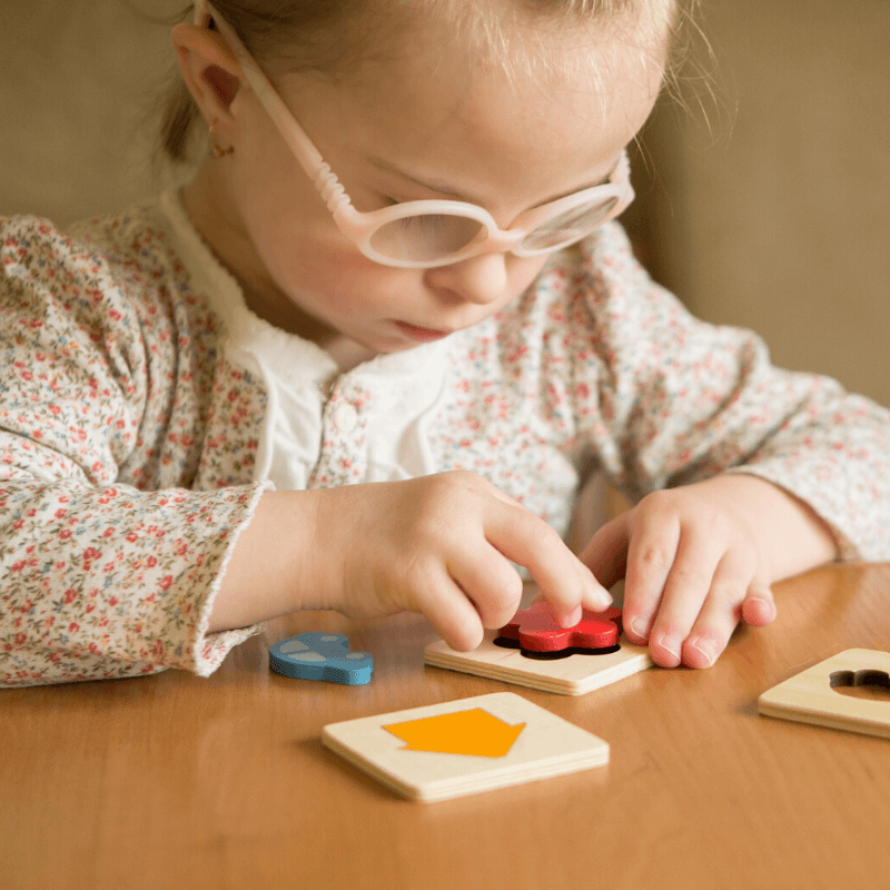 child playing with therapy toys